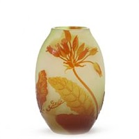 oval shaped vase of light green frosted glass overlaid with yellow and reddish glass by émile gallé