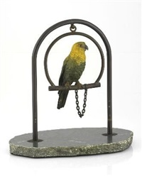 a cold-painted bronze figurine of a parrot on a stand by franz bergman