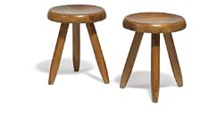 a pair of stained beech stools by charlotte perriand