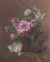 mixed roses in a glass vase by an ornamental enamel bowl on a draped table by m. pillon