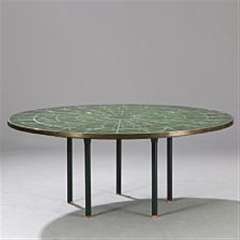 circular coffee table with green ornamented tiles, brass edge and