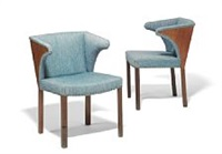 a pair of armchairs with legs by frits henningsen
