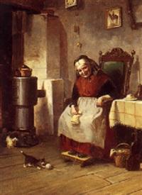 interior med ældre kone der strikker og kattekilling der leger med garnnogle by oluf simony jensen