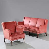 freestanding three seater sofa and easy chair with tapering mahogany legs by frits henningsen