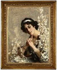 edwardian woman sitting in an armchair admiring a floral display by john leighton