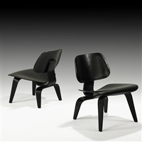 lounge chairs (lcw) (2 works) by evans products and charles and ray eames