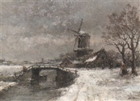 winter landscape with windmill and figures near a canal by arnold hendrik koning