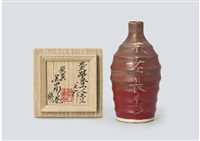 red silver sake pitcher with the design of perennial youth and long life by rosanjin kitaoji