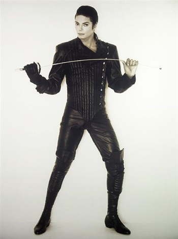 Portrait of Michael Jackson in fencing attire by Herb Ritts