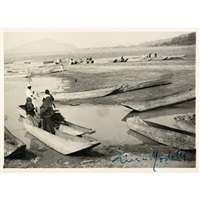 wood boats on the riverside by tina modotti