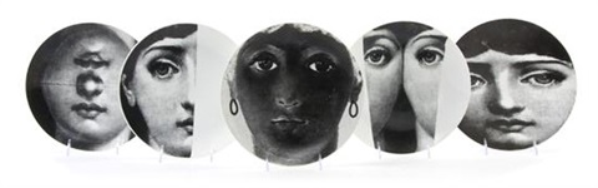 a set of thirteen fornasetti face plates