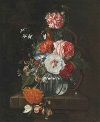 flowers in a glass bowl on a stone ledge with butterflies by david cornelisz heem iii