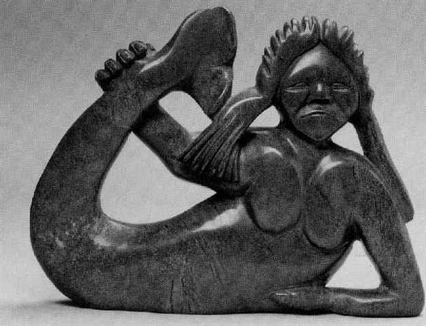 sedna reclining holding her upswept tail by koomwartok ashoona