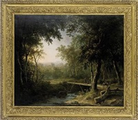 a wooded river landscape with a traveller crossing a bridge, a church beyond by abraham pether