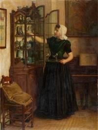junge magd vor einer geöffneten vitrine beim herausnehmen von gläsern by nicolaes van der waay