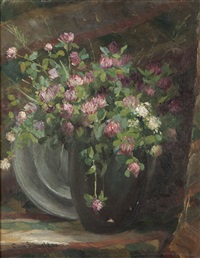 pink and white flowers in vase with a metal charger by christian von schneidau