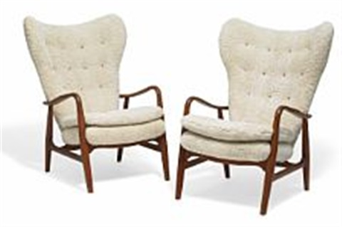 A pair of high back easy chairs with teak frames by Ib Madsen and ...