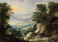 a mountainous landscape with two hermits by joos de momper the younger