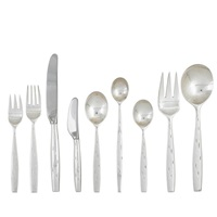 discovery 88-piece sterling flatware set for twelve (5-piece settings with extras) by raymond fernand loewy