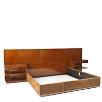 king-sized bed with headboard extensions and pair of nightstands by ralph lauren