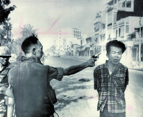 execution in saigon a viet cong officer is executed with a single pistol shot in the head by south vietnams national police by eddie adams