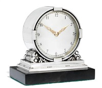 table clock with stylized ornamentation by johan rohde