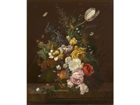 a still life with roses, a tulip and other flowers in an urn resting on a ledge by flemish school