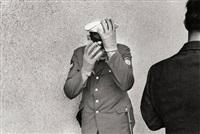 berliner polizist in abwehrstellung, west-berlin, 3. juni 1967 by michael ruetz