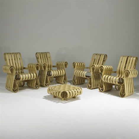 four power play armchairs and one ottoman by frank gehry