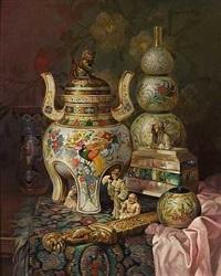 opstilling med orientalsk rogelseskar, gurdvase, bojan, perlemorsskrin og okimonofigurer by ludwig augustin