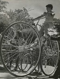 original photograph of cyclist on a large wheeled bicycle in bois de boulogne in paris by brassaï
