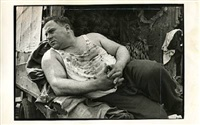 reclining man, not dated by henri cartier-bresson