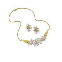 a necklace and a pair of matching ear clips (set of 2) by frederico buccellati