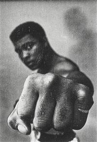 Muhammad Ali showing off his left fist,..., 1966