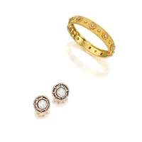 a bangle and a pair of ear clips (sest of 2) by frederico buccellati