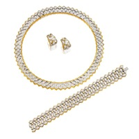 a necklace, bracelet and a pair of matching ear clips (set of 3) by frederico buccellati