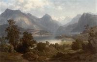 großes alpenpanorama mit dem kochelsee und der kirche st. bartholomae by leonhard rausch