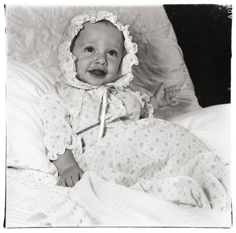 baby in a lacey bonnet by diane arbus