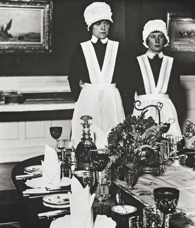 parlourmaid and under parlourmaid ready to serve dinner by bill brandt