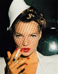 kate with fag in galliano, paris by roxanne lowit