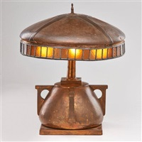 table lamp with domed shade bordered in leaded amber and base with four buttressed handles by arts & crafts mission
