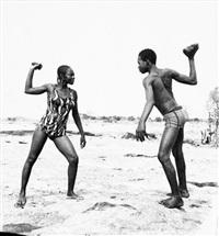 combat des amis avec pierres by malick sidibé