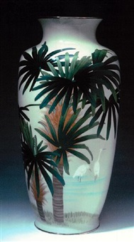 a tall vase with egrets, palm trees and grasses by jubei ando