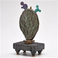 sculptural cactus lamp on attached stand by adrian saxe