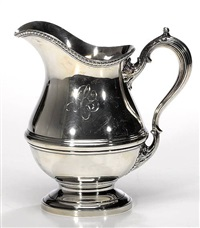 a water pitcher by redlich (co.)