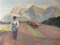 pflügender und säender vor malerischer bergkulisse by heinz theis