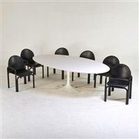 tulip dining table and six armchairs by eero saarinen