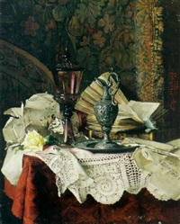 a still life with a pewter urn, books, music sheets and other objects on a table by fritzi mikesch