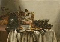 tafel mit schinken, zwei berkemeyergläsern, zinnkrug, einem goldpokal, austern auf einem silberteller, trauben und brot by adrian j. craen