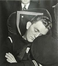 sailor asleep on train by esther bubley